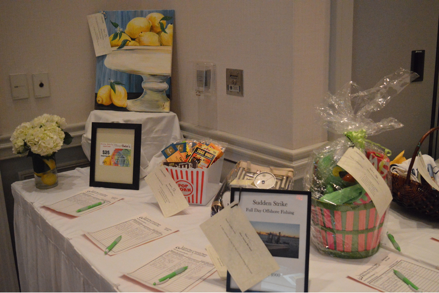 Paintings, popcorn and gift baskets were a part of the prizes on display at the Power of the Purse silent auction on Friday. Photo by Tim Briggs