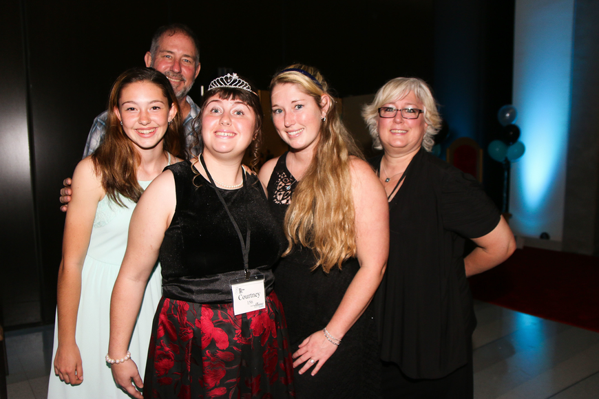 Port Orange residents Trinity, Byron, Courtney, Katie and Anne Widdison celebrate at Courtney's second Night to Shine. Photo by Paige Wilson