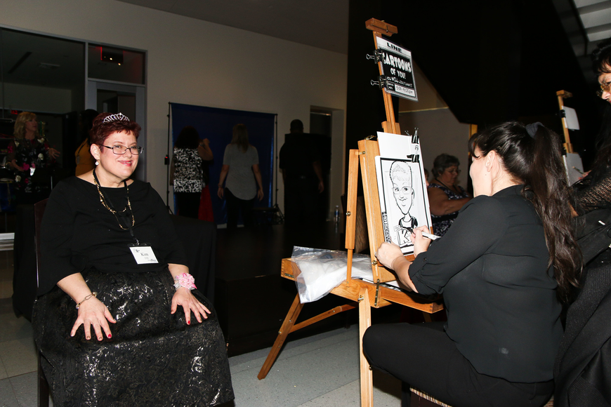 Kim Morris, of St. Augustine, gets a caricature drawn of her. Photo by Paige Wilson