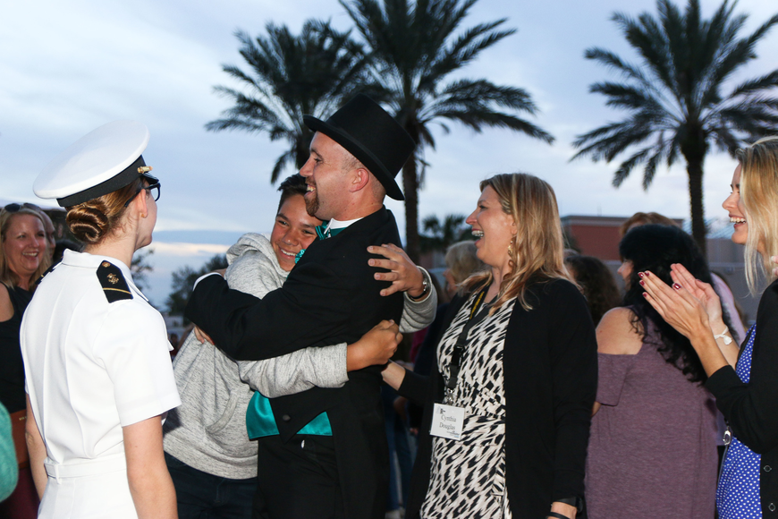 Tommy Caperton, of Fernandina Beach, stops to hug a friend on the red carpet. Photo by Paige Wilson