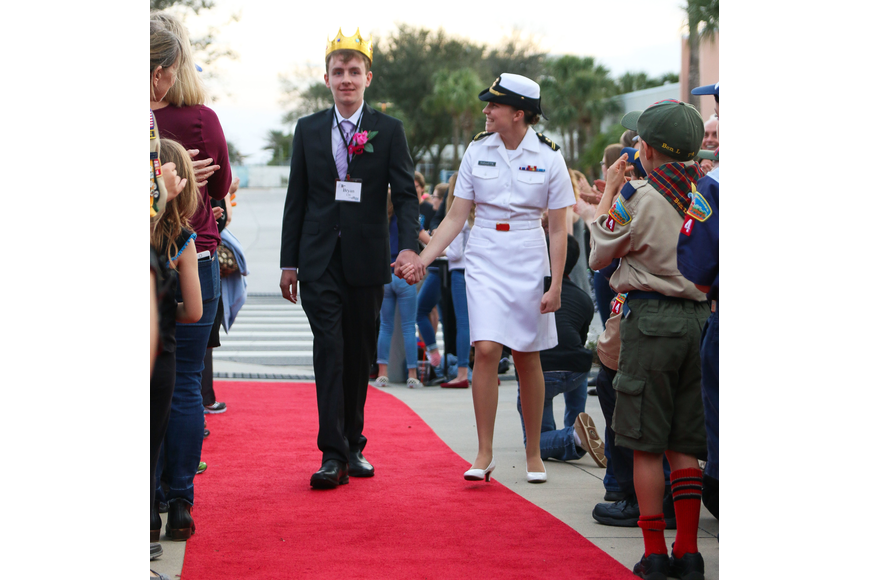 Bryan Sirmans, of Port Orange, gets escorted by an Embry-Riddle Navy ROTC student. Photo by Paige Wilson