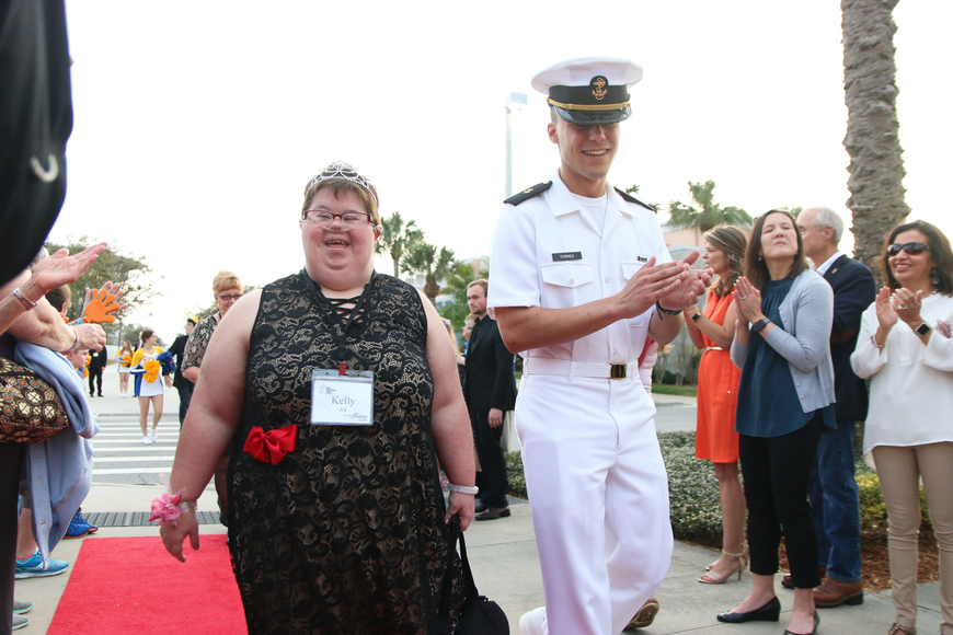 Kelly Jones, of Port Orange, gets escorted by an Embry-Riddle Navy ROTC student. Photo by Paige Wilson