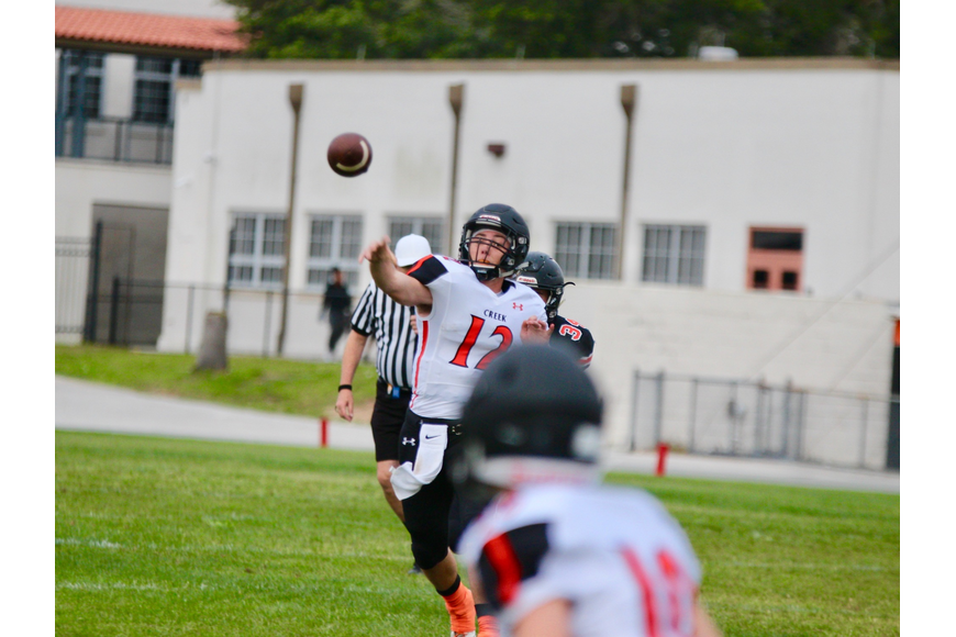 Freshman quarterback Andrew Acebal throws a pass against Leesburg. Photo by Ray Boone