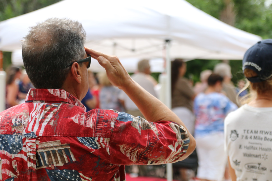 A man salutes during the Port Orange Memorial Day ceremony. Photo by Nichole Osinski
