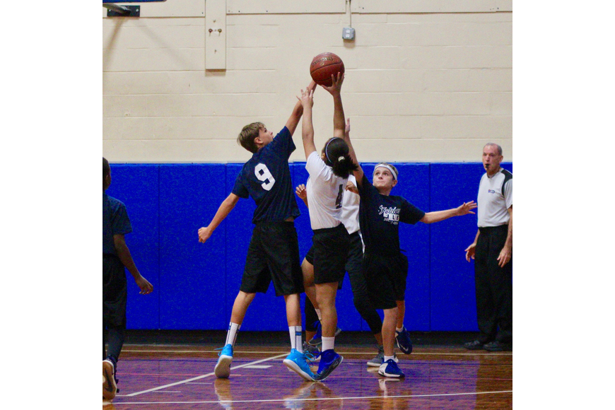 A player in the PAL blocks a shot during a game. Photo by Ray Boone