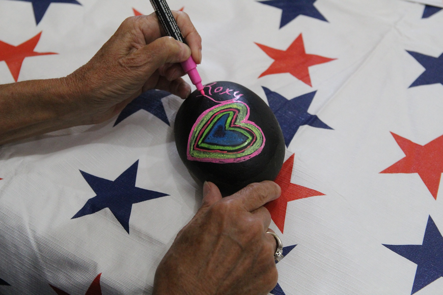 Carol Croft, of Port Orange, paints a rock to commemorate one of her deceased pets.