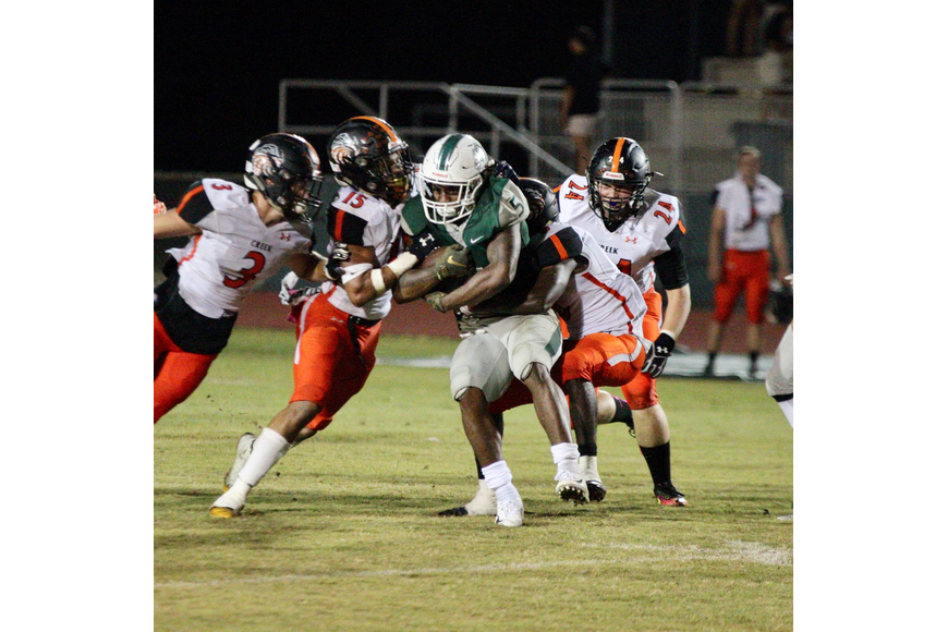 The Hawks tackle FPC's running back. Photo by Ray Boone