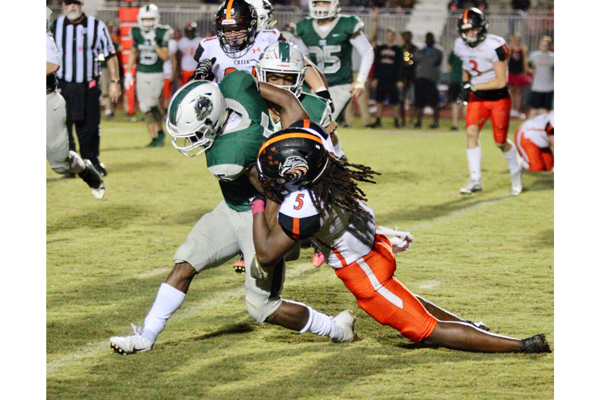 Spruce Creek's Dee'Shari Keith tackles FPC's running back. Photo by Ray Boone
