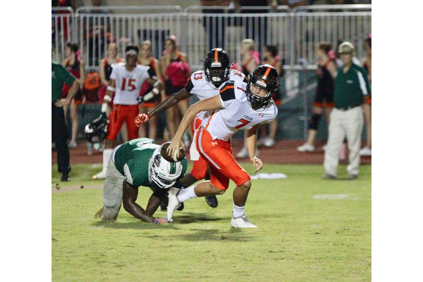 Nick Christiano avoids a sack against FPC. Photo by Ray Boone