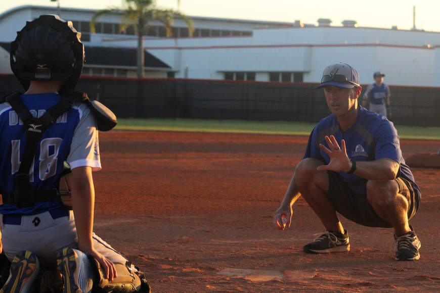 Coach Steve Strickland gives Parker Degrom some points on catching.