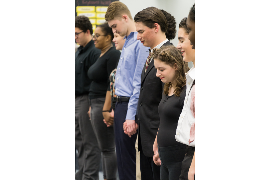 Kyle Bjorge, Cody Wyatt-Baranowski, lead tap dancer Leah Russo and dance captain Jordan Linton participate in the energy circle before the show on Friday, Nov. 30. Photo by Zach Fedowa