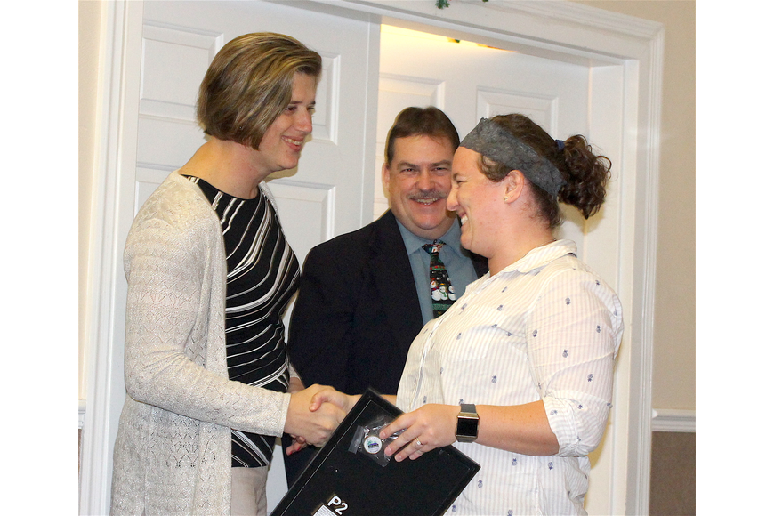 Immediate Past Board Chair Dr. Jamie Young and Port Orange Mayor Don Burnette congratulate Leadership 2018 Class member Hannah Merlo. Photo by Brian McMillan