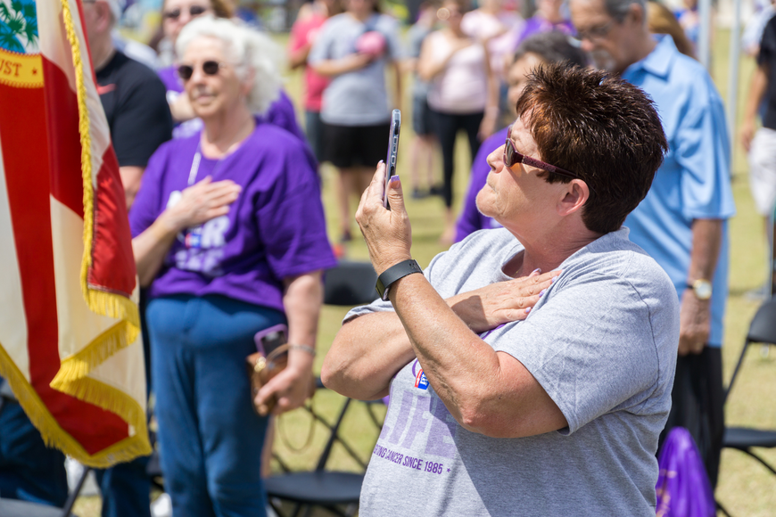 A cancer survivor participates in the pledge of allegiance at the 2019 Relay for Life at Riverwalk Park in Port Orange. Photo by Zach Fedewa
