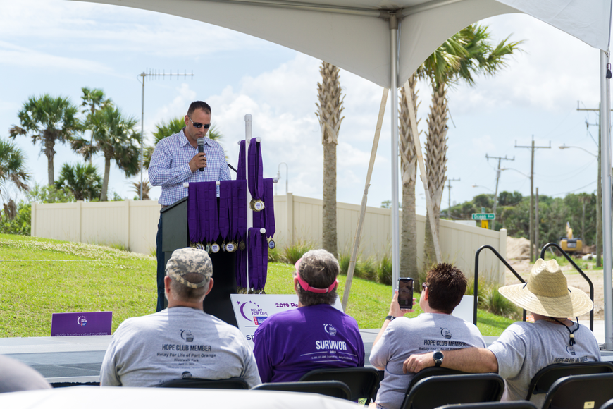 Councilman Chase Tramont addresses the crowd at the 2019 Relay for Life at Riverwalk Park in Port Orange. Photo by Zach Fedewa