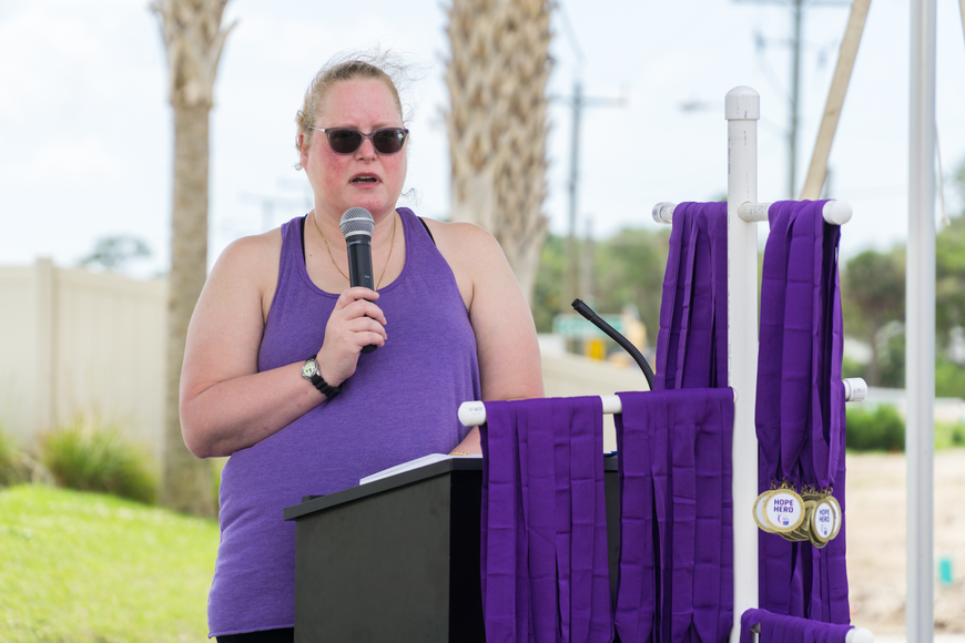 Julie Schlack shares her story at the 2019 Relay for Life at Riverwalk Park in Port Orange. Photo by Zach Fedewa