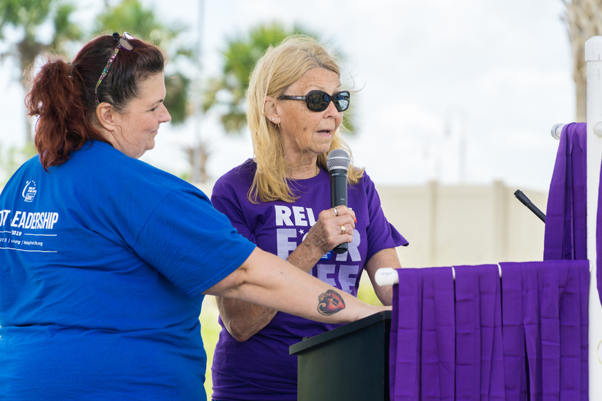 Cynthia Miller shares her story at the 2019 Relay for Life at Riverwalk Park in Port Orange. Photo by Zach Fedewa