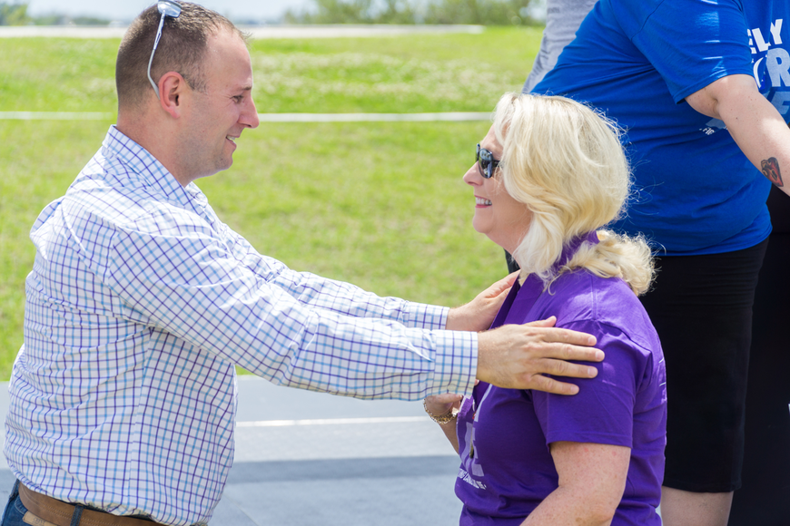 Lisa Stephen receives a survivor metal from Councilman Chase Tramont at the Relay for Life at Riverwalk Park in Port Orange. Photo by Zach Fedewa