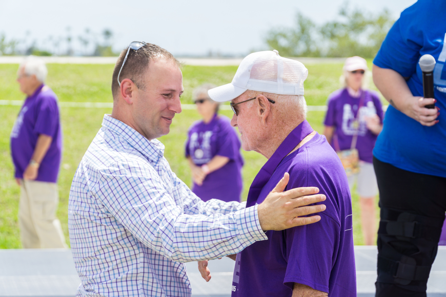 Bill Fricki receives a survivor metal from Councilman Chase Tramont at the Relay for Life at Riverwalk Park in Port Orange. Photo by Zach Fedewa